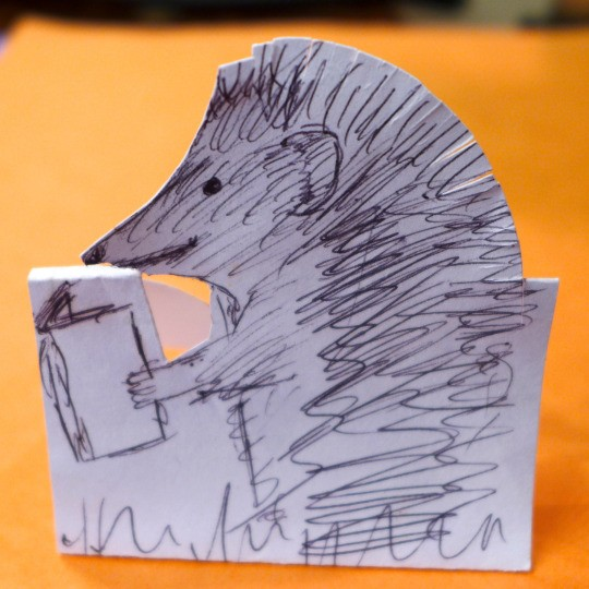 <b>Hedgie the Hedgehog</b> reads a book